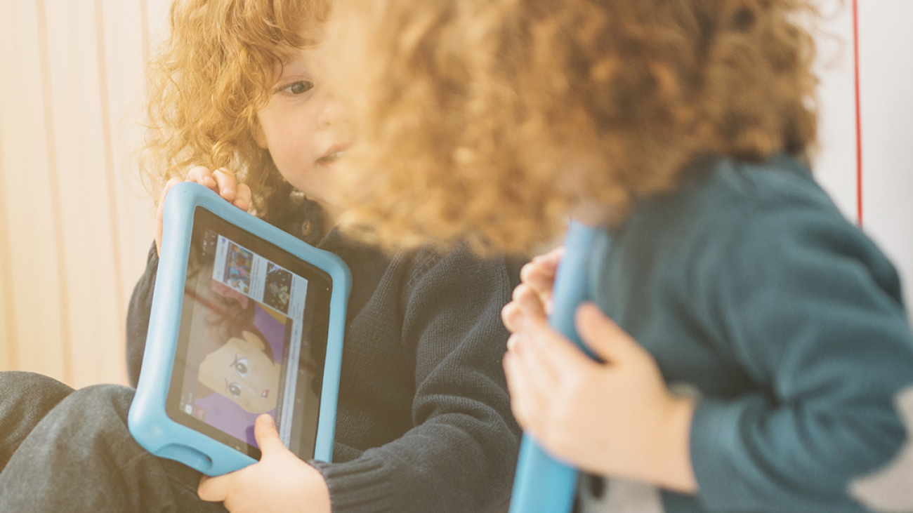 Two children on ipads