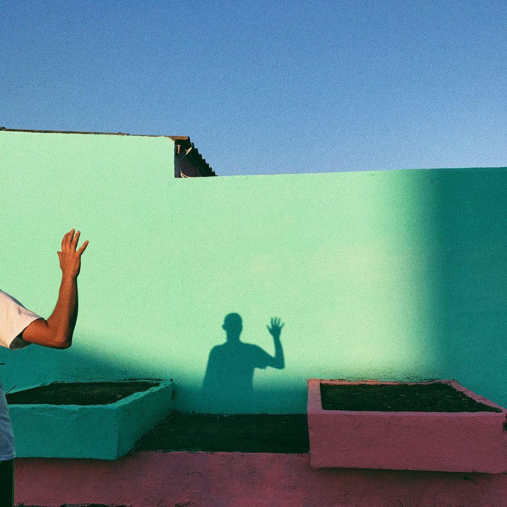 Man waving shadow