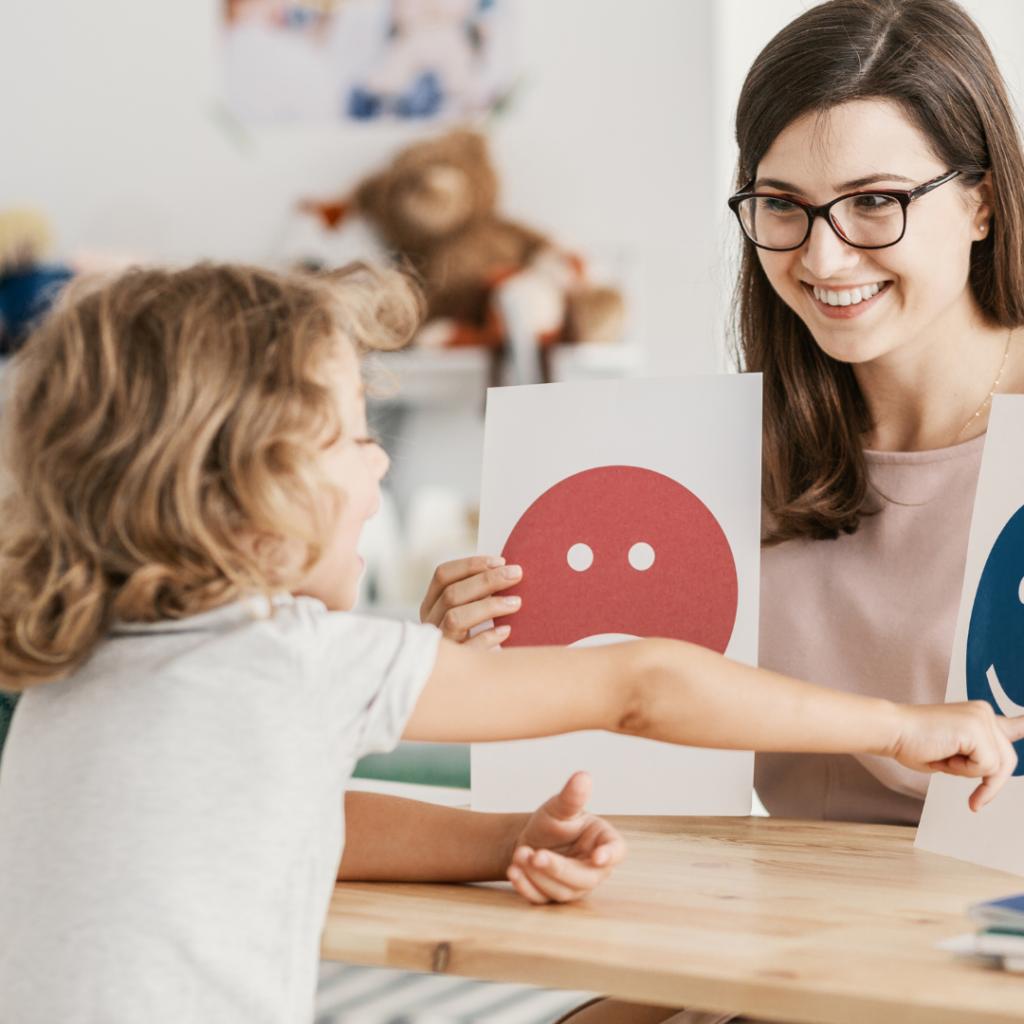 Female Childcare teacher with little girl
